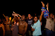 "Foreign tourists, principally backpackers and local Malawian get into the groove and dance late into the night with a mix of African bands and ""imported"" music from UK based DJ's at the Lake of Stars music festival, Chinteche, Malawi."