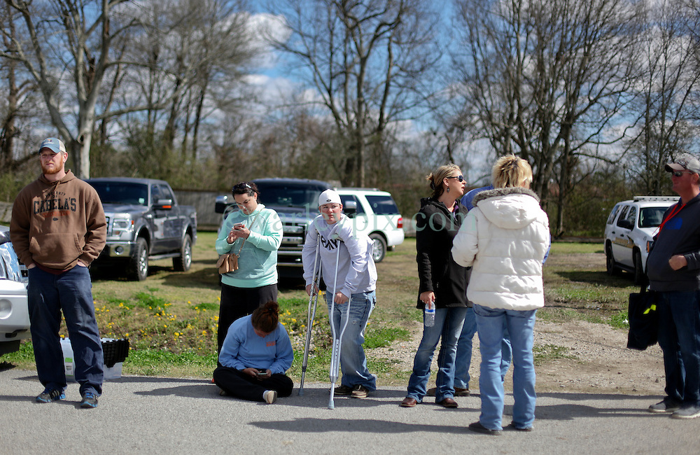 24 February 2016. Sugar Hill RV Park, Convent, Louisiana.<br /> Scenes of devastation following a deadly EF2 tornado touchdown. 2 confirmed dead. <br /> Residents including the walking wounded wait for permission to re-enter the devastated RV park in order that they might collect whatever belongings they can find in the rubble. <br /> Photo©; Charlie Varley/varleypix.com