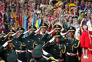 BEIJING, CHINA: The  Chinese Army stands at attention as the Chinese people sing their National Athem inside the National Stadium during the 2008 Olympiad Opening Ceremony in Beijing, China on Friday, 8/8/08. Thousands of athletes  from all over the world marched in the stadium representing their various countries and thousands of Chinese dancers thrilled the crowd..  ©2008 Johnny Crawford