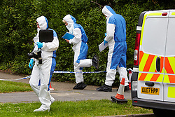 © Licensed to London News Pictures.  24/06/2013. AYLESBURY, UK. Forensic officers at the scene of a suspicious death in Aylesbury, Bucks. Thames Valley Police were called to a property in Belgrave Road, next to a local primary school,  at 10:43 last night (Sunday) and a man's body was found inside. The death is being treated as unexplained but suspicious. Photo credit: Cliff Hide/LNP