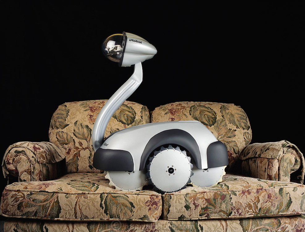 A protoype of the iRobot, a multi-purpose, web-controllable home robot built by the iRobot company. Following in the footsteps of other home robots like Sony's Aibo, iRobot Corporation of Somerville, Massachusetts has included more advanced features in the iRobot such as programmability, wireless Internet connectivity, and higher mobility. The robot is intended to bring tele-presence into the home with its cameras, microphones, mobility, Internet connection, and control-ability.