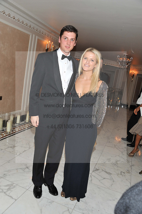 JAKE WARREN and ZOE STEWART at the 22nd Cartier Racing Awards held at The Dorchester, Park Lane, London on 13th November 2012.