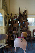 Stacked chairs in Al Hurriya, a cafe bar once popular with Leftist activists, Cairo, Egypt