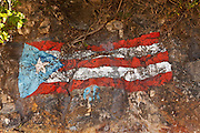 Puerto Rican flag painted on the rocks Crash Boat beach Aguadilla Puerto Rico