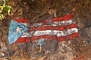 Puerto Rican flag painted on the rocks Crash Boat beach Aguadilla Puerto Rico