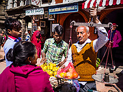 13 MARCH 2017 - PATAN, NEPAL: A street vendor sells fruit in Patan's Durbar Square.     PHOTO BY JACK KURTZ