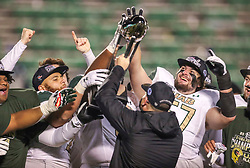 Dec 18, 2020; Huntington, West Virginia, USA; UAB Blazers head coach Bill Clark raises the trophy after defeating the Marshall Thundering Herd for the Conference USA Championship at Joan C. Edwards Stadium. Mandatory Credit: Ben Queen-USA TODAY Sports