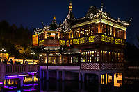 Shanghai, China - April 7, 2013: ancient tea house Fang Bang Zhong Lu old city at night in the city of Shanghai in China on april 7th, 2013