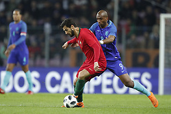 (L-R) Andre Gomes of Portugal, Ryan Babel of Holland during the International friendly match match between Portugal and The Netherlands at Stade de Genève on March 26, 2018 in Geneva, Switzerland