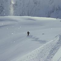 Rare solar refraction off snow flakes, Mont Blanc Region, France, skier Jean Franck Charlet.