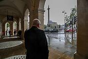 London, United Kingdom, May 18, 2021: A man observes people rushing to take cover in Trafalgar square as heavy rain hits central London on Tuesday, May 18, 2021. (Photo by Vudi Xhymshiti/VXP)