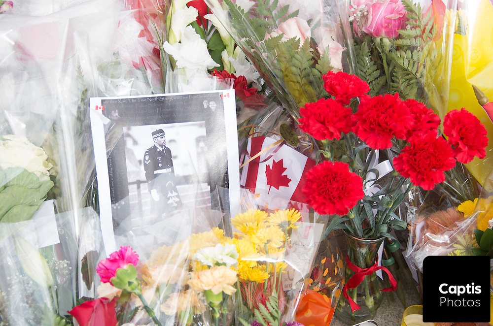 A photo of Cpl. Nathan Cirillo surrounded by flowers at the National War Memorial. October 25, 2014.