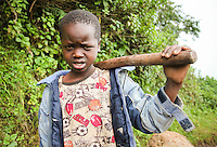Ugandan village boy with an angry frown poses for me in Sipi Falls.