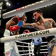 HOLLYWOOD, FL - APRIL 17:  Ortha Jones III stops a punch from Jorge Castaneda at Seminole Hard Rock Hotel & Casino on April 17, 2021 in Hollywood, Florida. (Photo by Alex Menendez/Getty Images) *** Local Caption *** Ortha Jones III; Jorge Castaneda