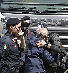 May 1, 2019 - Piacenza, Italy - 33 porters are fired for defending their rights. Supported by the Usb they occupy the roof of the GLS company for 16 days..Today, May 1, they go down and embrace their families. The ministry opened the negotiation, guaranteeing the reinstatement. (Credit Image: © Elisa Bianchini/Pacific Press via ZUMA Wire)
