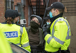 © Licensed to London News Pictures; 10/03/2021; Bristol, UK. A squatter is arrested by police after being evicted from a large empty office building by Police and bailiffs on Gloucester Road in North Bristol. The squatters say they are called The Pigeon Shit Collective, because of the Government's failings, and they are giving support to homeless people and those in need during the covid-19 coronavirus pandemic. Photo credit: Simon Chapman/LNP.