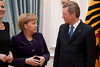 13 JAN 2011, BERLIN/GERMANY:<br /> Angela Merkel (L), CDU, Bundeskanzlerin, und Christian Wulff (R), Bundespraesident, im Gespraech, Neujahrsempfang des Bundespraesidenten, Schloss Bellevue<br /> IMAGE: 20110113-01-084<br /> KEYWORDS: Bundespräsident, Gespräch