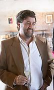 Q Fernando Deicas, president and owner in the tasting room. Bodega Juanico Familia Deicas Winery, Juanico, Canelones, Uruguay, South America