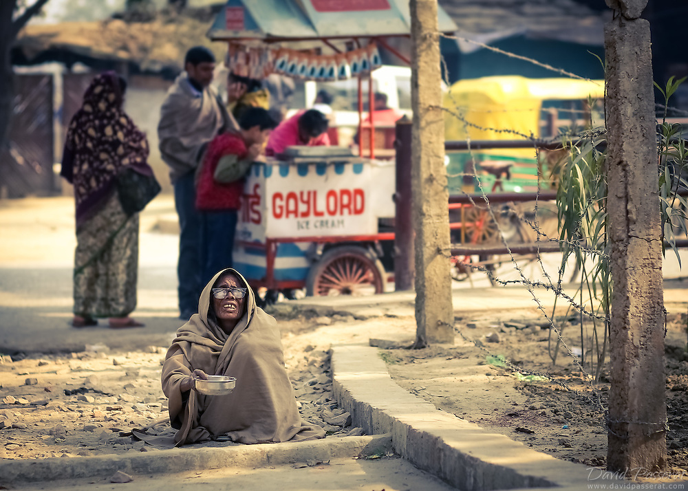 One of the numerous beggar in the street of Varanasi, where healthy people pass by the homeless with no notice.