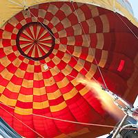 Participant heats hair in the balloon during the Velence Lake International Hot Air Balloon Festival in Agard, Slovakia on September 10, 2011. ATTILA VOLGYI
