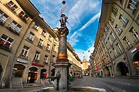 Musketeer Fountain (Schutzenbrunnen) with the Clock Tower (Zytglogge) in background, Bern, Canton Bern, Switzerland