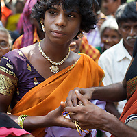 Aravanis gather in the village of Koovagam to celebrate the Hindu marriage of Aravan to Lord Krishna...India's transexual community has a recorded history of more than four thousand years. Many consider the The Third Sex, also known as Aravanis, to posses special powers allowing them to determine the fate of others. As such, they are not only revered but despised and feared too. Resigned to the fringes of society, segregated and excluded from most occupations, many Aravanis are forced to turn to begging and sex work in order to earn a living. ..The annual transgender festival in the village of Koovagam, near Vilappuram, offers an escape from this often desolate existence. For some, the week-long partying and frenetic sex trade that culminates in the Koovagam festival is about fulfilling lustful desires. For others, the gathering provides a chance for transgenders to bond, share experiences, join the wider homosexual gay-community and coordinate their campaign for recognition and tackle the challenge of HIV/AIDS. ..It is the Indian state of Tamil Nadu that the eighty-thousand-strong Aravani community has made advances in their fight for rights. In 2009, the Tamil Nadu state government began providing sex-change surgery free of cost. The state has also offers special third-gender ration cards, passports and reserved seats in colleges. And 2008 the launch of Ippudikku Rose, a Tamil talk-show fronted by India's first transgender TV-host and the release of a mainstream Tamil film staring an Aravani in the lead-role. ..These advances clearly signal a victory for south India's transgenders, but they have also exposed deep divisions within the community. There is a very real gulf that separates the majority poor from their potentially influential but often reticent, upper-class sisters. ..Photo: Tom Pietrasik.Vilappuram District, Tamil Nadu. India.May 2009