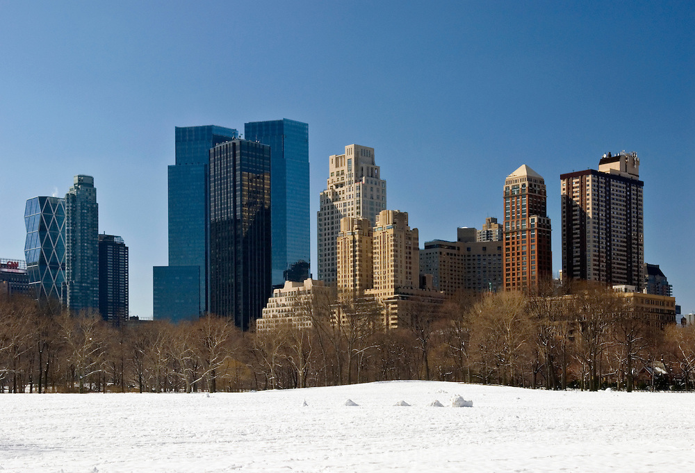 View of the New York City Skyline from Sheep Meadow in Central Park. Buildings include the Time Warner Center, Trump International Hotel and Tower, Hearst Tower and apartments on Central Park West.