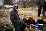 A 15 years old child from Pakistan is seen in a makeshift camp not far from Subotica, hundreds migrants are liveing here fleen the Serbian police that try to bring them in governament camps. Subotica Serbia. March 18th, 2017. Federico Scoppa