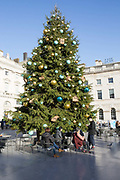 A giant Fortnum & Mason Christmas tree at Somerset House on the 11th December 2018 in London in the United Kingdom. Somerset House is a Neoclassical building on the south side of the Strand, overlooking the River Thames.