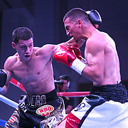 """Jean Carlos """"Chapito"""" Rivera (L) and  Jason Sanchez exchange blows during their championship boxing match for the WBO Junior World Title at the Hotel El Panama Convention Center on Wednesday, October 31, 2018 in Panama City, Panama. (Alex Menendez via AP)"""