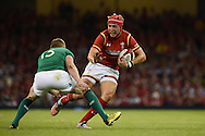Tyler Morgan of Wales looks to go past Ireland's Keith Earls.Wales v Ireland rugby union international, RWC warm up friendly match at the Millennium Stadium in Cardiff, South Wales on Saturday 8th August  2015.<br /> pic by Andrew Orchard, Andrew Orchard sports photography.