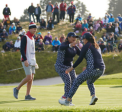 Solheim Cup 2019 at Centenary Course at Gleneagles in Scotland, UK. Lizette Salas of USA  is congratulated by Angel Lin (r) on 18th green after winning match.