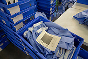 Stacks of blue boxes containing prison uniform blue boxer shorts that need to be sewn and finished in the Industries Department Industries Department in Her Majesty's Prison Pentonville, London, United Kingdom.  Prisoners are encouraged to work or take courses to learn new skills to help rehabilitation and reduce re-offending rates on their release. (Photo by Andy Aitchison)