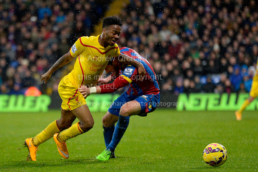 Raheem Sterling of Liverpool being handled by Joel Ward of Crystal Palace in the box. Barclays Premier league match, Crystal Palace v Liverpool at Selhurst Park in London on Sunday 23rd November 2014.<br /> pic by John Patrick Fletcher, Andrew Orchard sports photography.