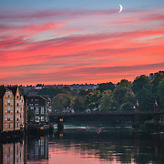 What do you need for a good landscape photo. Subject, colors, background, foreground and middle ground? Well here I have them all :). This is Trondheim where I have most of my photos from.  This picture has been taken with almost 50-60 years old Leica lens. I was lucky enough to spot the moon, kayak and birds to complement the photo. more photos: |Website| ,