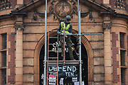 Workmen begin erecting scaffolding to the front of the Grade II listed public Carnegie Library in Herne Hill, closed by Lambeth council in 2016 to partially-convert it into a gym - something locals and library users say they don't want or need, on 15th November 2017, in London, England.