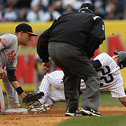 Jacoby Ellsbury, New York Yankees, is caught stealing by Ryan Flaherty, Baltimore Orioles, during the New York Yankees V Baltimore Orioles home opening day at Yankee Stadium, The Bronx, New York. 7th April 2014. Photo Tim Clayton