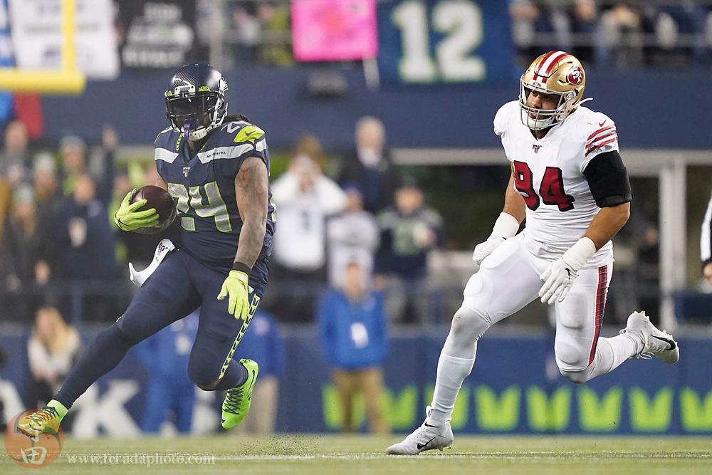December 29, 2019; Seattle, Washington, USA; Seattle Seahawks running back Marshawn Lynch (24) runs against San Francisco 49ers defensive end Solomon Thomas (94) during the third quarter at CenturyLink Field.