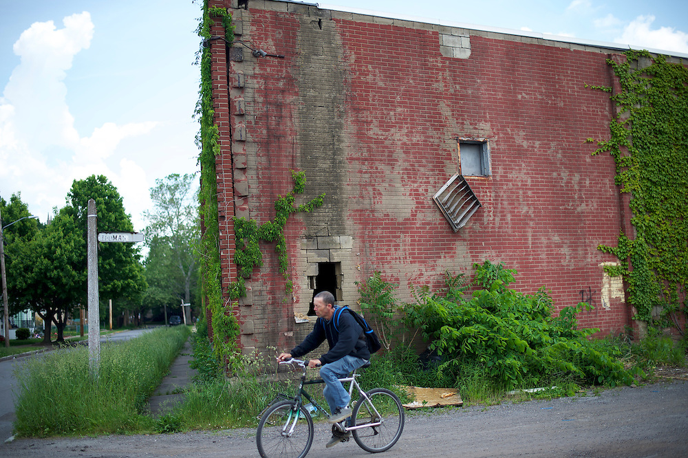 WILKES-BARRE- May 27, 2016.  A man cycles past a closed factory in Wilkes-Barre, PA, a city of 41,000 in central Pennsylvania.  Wilkes-Barre is the county seat of Luzerne County, in which 77.4% of Republicans voted for Donald Trump.