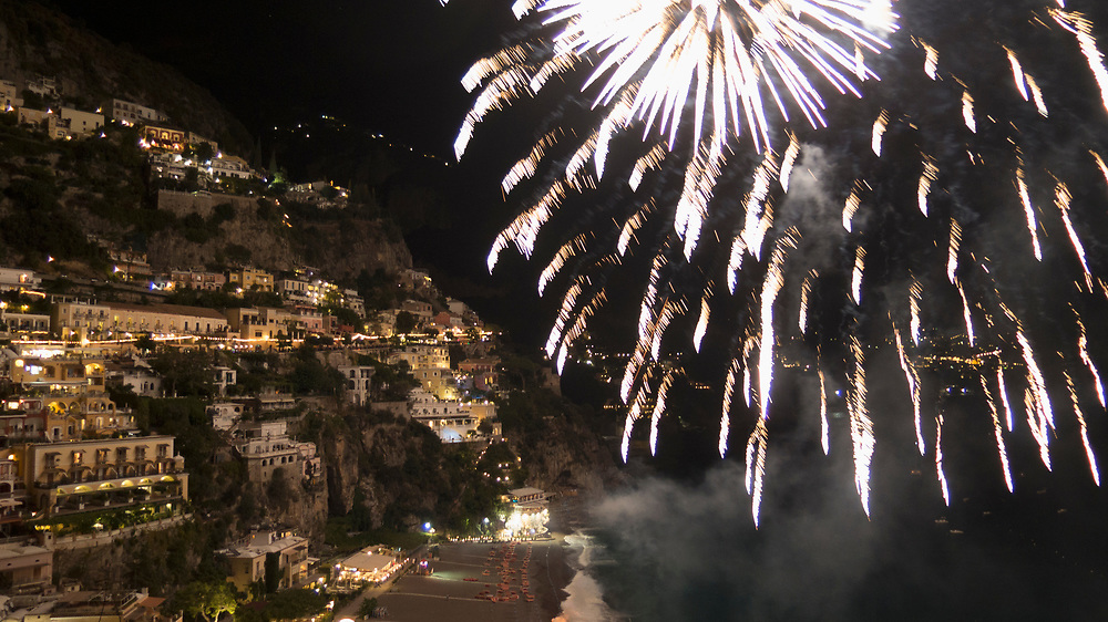 Colorful Buildings in Positano<br /> Hillside houses on the cliff with night time fireworks celebration