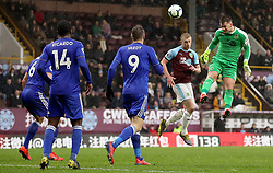 Burnley's goalkeeper Thomas Heaton (right) jumps to head the ball during the Premier League match at Turf Moor, Burnley.