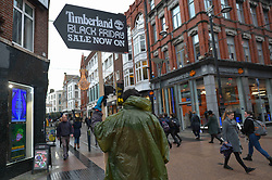 November 21, 2018 - Dublin, Ireland - A man holds Sales sign on Grafton Street shops ahead of Black Friday, regarded as the beginning of the Christmas shopping season. .Major retailers will open very early and stay open late offering promotional sales..On Wednesday, November 20, 2018, in Dublin, Ireland. (Credit Image: © Artur Widak/NurPhoto via ZUMA Press)