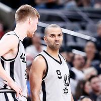02 April 2017: San Antonio Spurs forward Davis Bertans (42) talks to San Antonio Spurs guard Tony Parker (9) during the San Antonio Spurs 109-103 victory over the Utah Jazz, at the AT&T Center, San Antonio, Texas, USA.