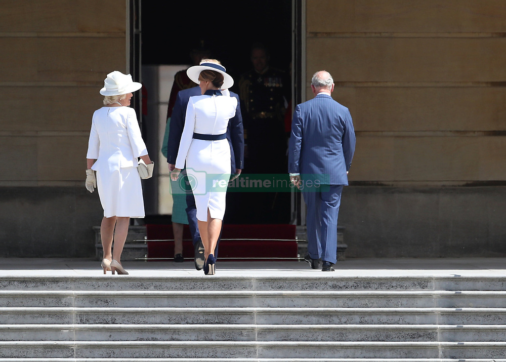 The Prince of Wales and the Duchess of Cornwall with US President Donald Trump and his wife Melania after they arrived in Marine One at Buckingham Palace, in London on day one of his three day state visit to the UK.