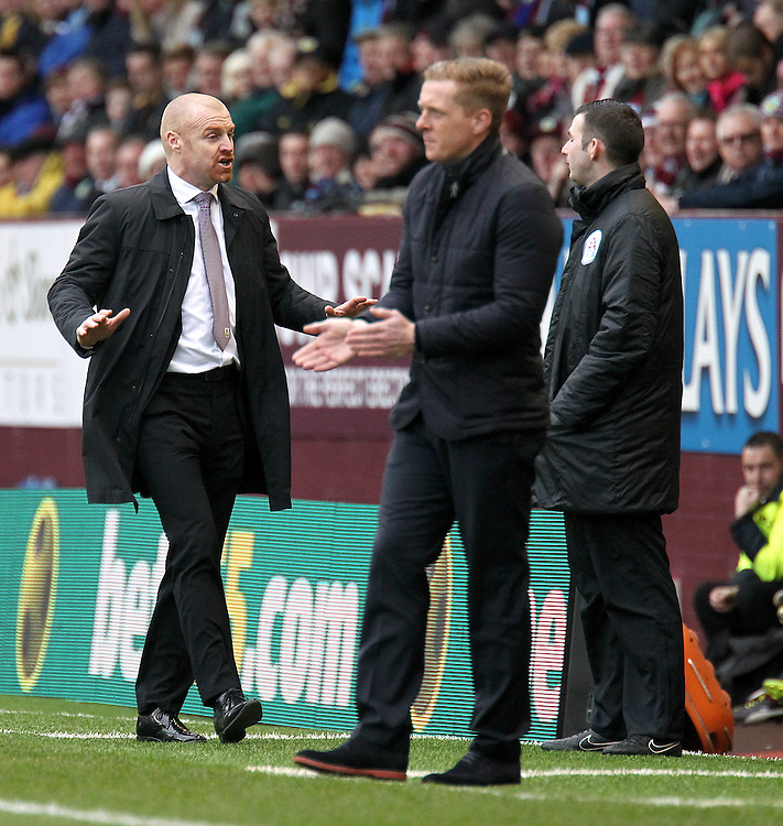 Burnley manager Sean Dyche and Swansea City manager Garry Monk on the touchline<br /> <br /> Photographer Rich Linley/CameraSport<br /> <br /> Football - Barclays Premiership - Burnley v Swansea City - Friday 27th February 2015 - Turf Moor - Burnley<br /> <br /> © CameraSport - 43 Linden Ave. Countesthorpe. Leicester. England. LE8 5PG - Tel: +44 (0) 116 277 4147 - admin@camerasport.com - www.camerasport.com