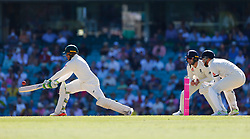 Australia's Usman Khawaja hits a shot as Jonny Bairstow looks on during day two of the Ashes Test match at Sydney Cricket Ground.