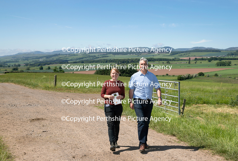 Quality Meat Scotland (QMS) Better Grazing meeting at Newmiln Farm, Tibbermore, Perth<br />Farmer Hugh Grierson and Poppy Frater of SAC<br />Picture by Graeme Hart.<br />Copyright Perthshire Picture Agency<br />Tel: 01738 623350  Mobile: 07990 594431