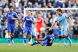 David Silva of Manchester City protests his innocence as Willian of Chelsea appeals for a fouls - Photo mandatory by-line: Rogan Thomson/JMP - 07966 386802 - 21/08/2014 - SPORT - FOOTBALL - Manchester, England - Etihad Stadium - Manchester City v Chelsea FC - Barclays Premier League.