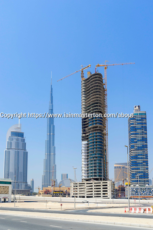 construction of new apartment towers and Burj Khalifa in Business Bay district in Dubai United Arab Emirates