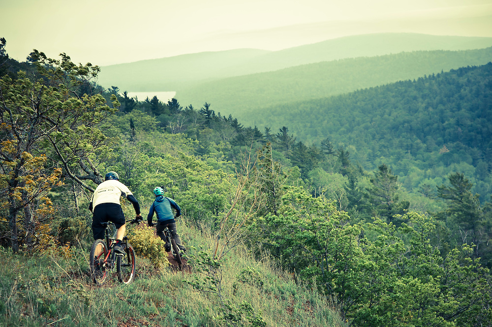 Mountain bikers ride On the Edge a trail on Brockway Mountain in Copper Harbor Michigan.